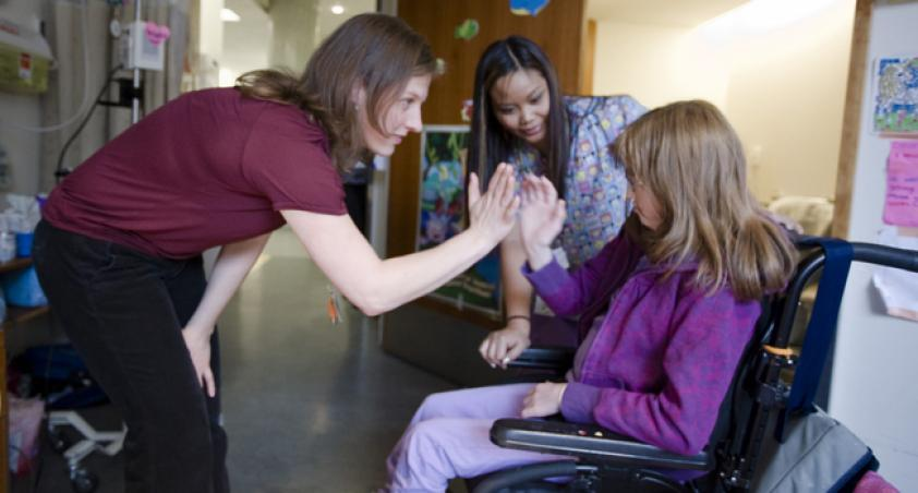 Client in a wheelchair with staff