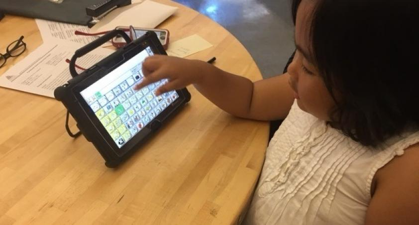 Girl using Assistive Technology device