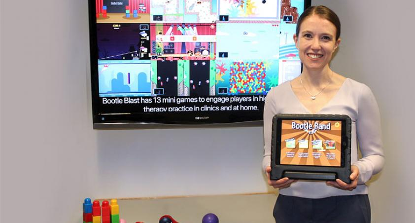scientist holding a tablet with a game design