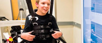 Boy in harness smiling