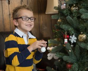 Alex decorating the Christmas tree