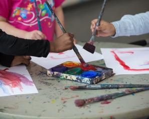 Close-up of kids painting.