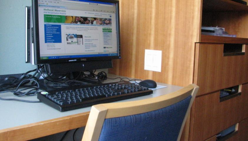 Computers, desks, televisions, and sleeper chairs are available in client rooms