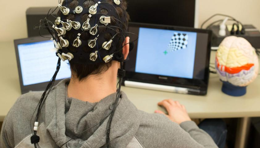 Person wearing EEG brain-computer interface device