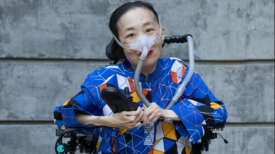 Photo of an Asian American woman in a power chair
